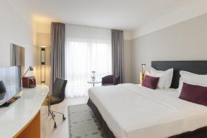 A bed or beds in a room at Mercure Kamen Unna