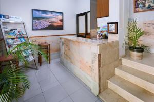 El vestíbulo o zona de recepción de Hotel Niza