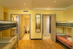 A bunk bed or bunk beds in a room at Villa Saint Exupery Beach Hostel