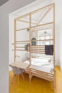 A bunk bed or bunk beds in a room at Flow Spaces