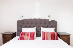 A bed or beds in a room at Best Western City Hotel Leiden