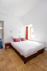 Een bed of bedden in een kamer bij Best Western City Hotel Leiden