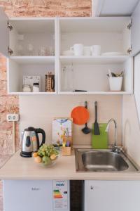 Кухня или мини-кухня в AG-APART 26/27