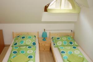 Кровать или кровати в номере Rooms Novobranská - Orlí