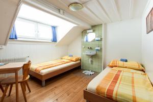 Cama o camas de una habitación en Happy Inn Lodge