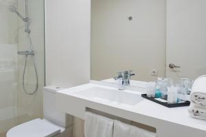 Un baño de Hotel Lauria