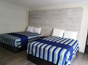 A bed or beds in a room at Mallorca Hotel