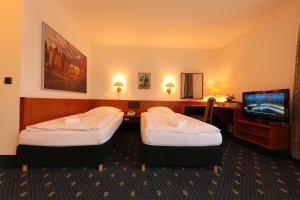 Ein Bett oder Betten in einem Zimmer der Unterkunft Karaman Group Hotel