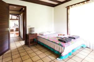 Cama ou camas em um quarto em MOOREA - Fare Tianina Dream