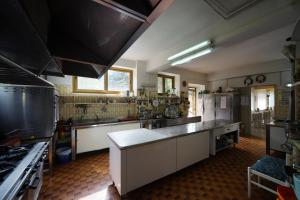 A kitchen or kitchenette at King Hotel
