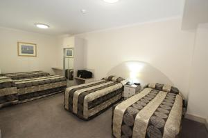 A bed or beds in a room at Comfort Inn & Suites Goodearth Perth
