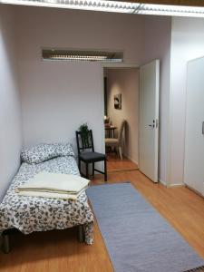Vuode tai vuoteita majoituspaikassa RBA RentHouse Apartment 1