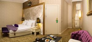 Кровать или кровати в номере Teatro Boutique Hotel
