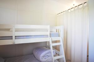 A bunk bed or bunk beds in a room at 45 HALFORD - PET FRIENDLY