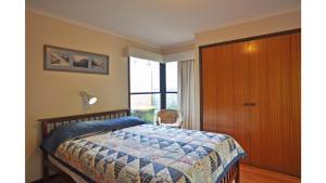 A bed or beds in a room at SURF PLAZU - SURF SIDE
