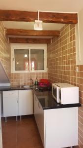 Una cocina o zona de cocina en Casa Mica