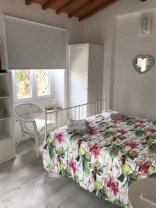 Un ou plusieurs lits dans un hébergement de l'établissement Il Casalone