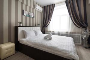 Кровать или кровати в номере MosApts 2 near Moscow City - 2 rooms