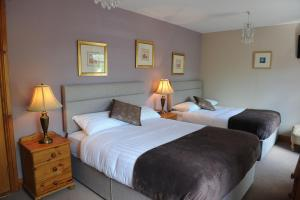 A bed or beds in a room at Avondale Farmhouse B&B