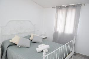 A bed or beds in a room at Le Volte - Locazione Turistica