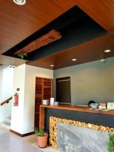 The lobby or reception area at Acacia Garden Inn