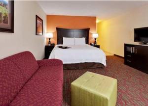 A bed or beds in a room at Hampton Inn Seneca Falls
