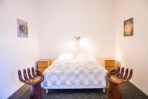 A bed or beds in a room at Höfn Inn Guesthouse