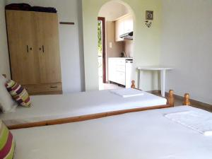 A bed or beds in a room at Studios Dimitris
