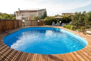 The swimming pool at or near Ktima Nikolaos