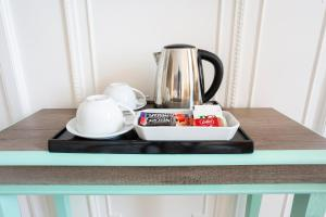 Coffee and tea-making facilities at Astor Court Hotel