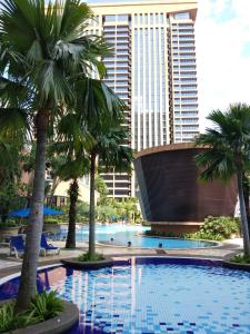 The swimming pool at or close to Bintang Service Suite at Times Square