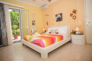 A bed or beds in a room at Dimitra Apartments & Studios