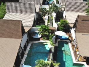A view of the pool at Kaleydo Villas or nearby