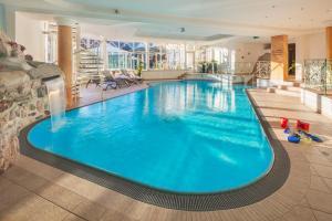 The swimming pool at or near Apparthotel Talhof, Restaurant, Pool und Spa