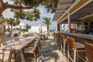 A restaurant or other place to eat at Poseidon Hotel Suites