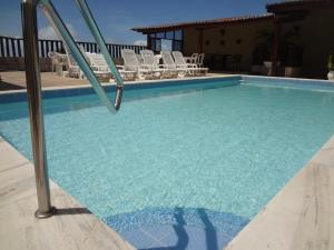 The swimming pool at or near Laina´s Place Hotel