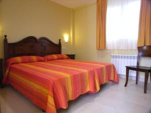 Cama o camas de una habitación en Apartamentos Playa de Toró