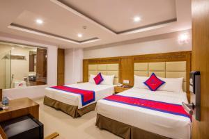 Кровать или кровати в номере Sun City Hotel