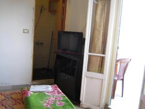 تلفاز و/أو أجهزة ترفيهية في فندق طلال