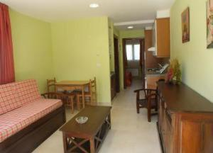 Zona de estar de Apartamentos Playa de Toró