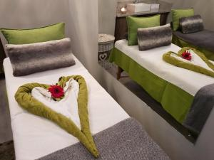 A bed or beds in a room at Chill Pepper Boutique Hotel