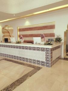 The lobby or reception area at Golden Dune Hotel
