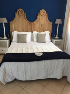 A bed or beds in a room at Relais Fenicottero Rosa