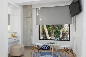 A television and/or entertainment center at Lyristis Studios & Apartments