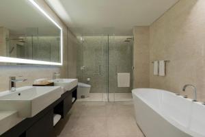 A bathroom at Sedona Suites Ho Chi Minh City