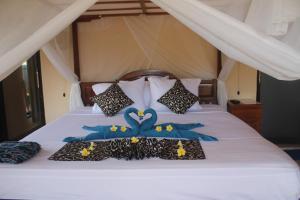 Ein Bett oder Betten in einem Zimmer der Unterkunft Summer Guesthouse Lovina