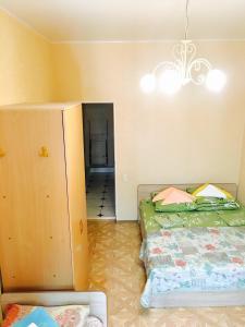 Кровать или кровати в номере Apartments Gorkogo 21