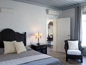 A bed or beds in a room at Porto Kea Suites