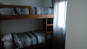A bunk bed or bunk beds in a room at VistaFreita- Rooms & Suites