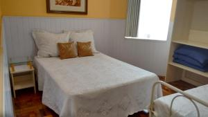 A bed or beds in a room at Hotel Ivo De Conto